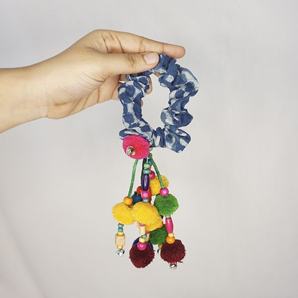 Indigo scrunches with multicolored boho hangings